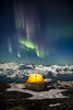 Aurora over camp and icebergs, Greenland
