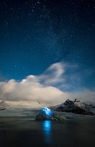 Climbing icebergs at Fjallsarlon Glacier