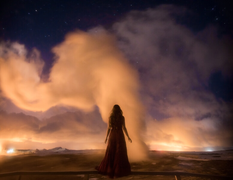 Woman at Gunnuhver Hot Springs under the stars