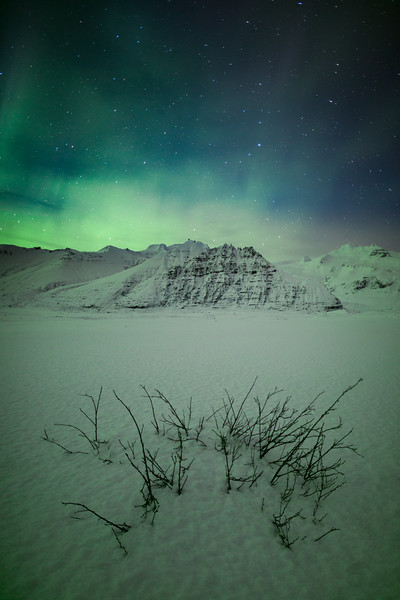 Aurora Borealis over mountains of Skaftafell