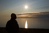 Silhouette of young man watching the midnight Sun above the Arctic Ocean, Spitsbergen, Svalbard, Norway, Scandinavia