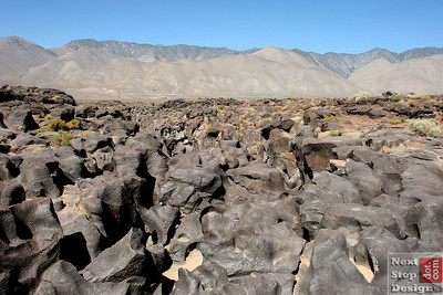 "Fossil Falls are volcanic rock (basalt?) that have been sculpted by the Owens River that used to flow through this valley.  The ""fossil"" is of the river itself.  Very cool."