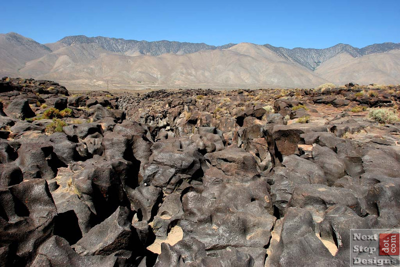Fossil Falls right off the 395 highway, about 30 miles before Olancha (near the big red volcano cinder cone).  The Owens River used to flow through this area, and where it ran through a volcanic basalt lava field, it sculpted the rock into very interesting forms.  Tremendous fun to climb on and play in.  Watch your step!