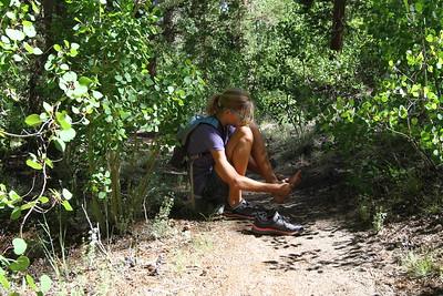 Megan making a field adjustment on the trail