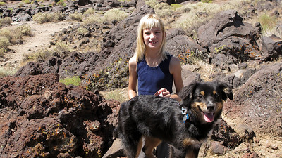 Megan and Cocoa exploring the lava fields at Fossil Falls