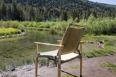 Enjoying Rock Creek at our campsite.  Chair by Campaign Furniture Company