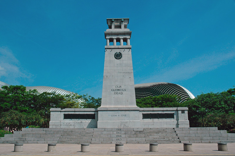 Standing tall at 10 metres in Esplanade Park, the Singapore Cenotaph made from smooth granite is close to the entrance to the Singapore River in the park area before the old Singpaore Club. It commemorates both World War 1 and World War 2 but only contains the names of those who died during World War 1. The two World Wars are on opposite sides of the memorial and each year of the war is carved into an individual step of the memorial. Singapore Feb'2005.