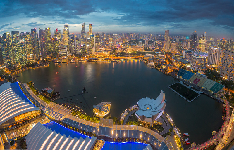 Ariel view of CBD, Singapore from Sands SkyPark Observation Deck on the 57th floor. Deck has panoramic city views & 2 upscale restaurants and a pool for hotel residents.