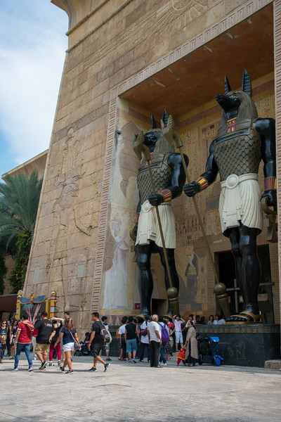 """Visitors in front of the replica statues of Ancient Egypt, Universal Studios, Resorts World Sentosa, Singapore.<br /> <br /> Ancient Egypt is based on the historical adaptation of Ancient Egypt during the 1930s Golden Age of Egyptian Exploration. It features obelisks and pyramids which are typical of Ancient Egypt. Also featured are Pharaohs' tombs and depictions in the popular film, """"The Mummy""""."""