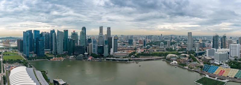 Panoramic aerial view of Marina Bay in the evening, Singapore. Seen from Sands SkyPark Observation Deck, on the 57th floor.