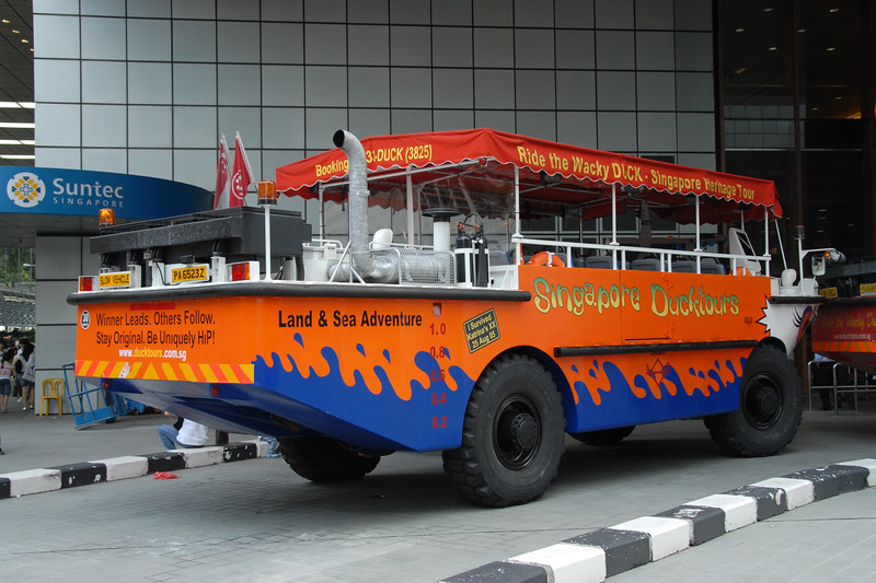 Singapore Ducktours - land and sea adventures.<br /> City Sightseing Bus including the frog and amphibious vehicles. Singapore, South East Asia.