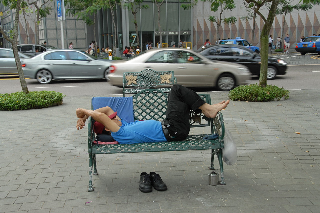 """Streets of Singapore - time for an afternoon siesta.<br /> The Fountain of Wealth (Chinese: 财富之泉), Singapore.<br /> <br /> The Guinness Book of Records in 1998 listed this as the largest fountain in the world. Located in one of Singapore's largest shopping malls, Suntec City, at regular intervals, the fountain is turned off and visitors are invited to walk around a mini fountain at the centre of the fountain's base for good luck. At night, the fountain is the setting for laser performances, as well as """"live"""" song and laser message dedications."""