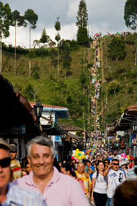 People climbing to the top of the hill in order to get a panoramic view of the town.