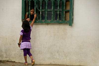 Two girls playing in the small town.