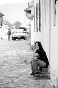 Yenny relaxing while taking in the beautiful view of the cobblestone streets.
