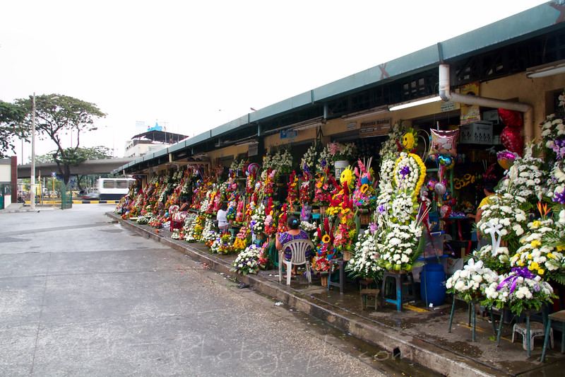 Ladies selling flowers at the flower market - Guayaquil
