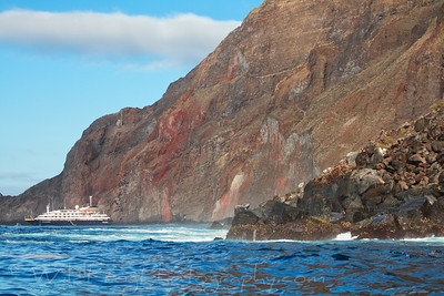 The Silver Galapagos at Anchor under Cliffs - Galapagos Islands