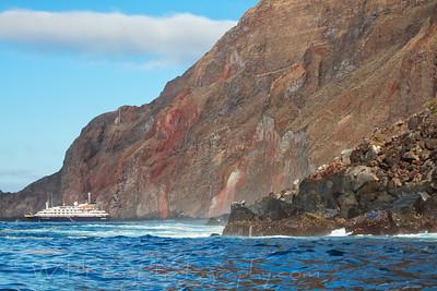 The Silver Galapagos at Anchor under Cliffs - Galapagos Islands