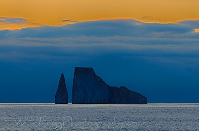 Storm clouds and sunset with Boot rock in foreground