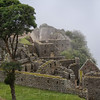 Fog about to cover part of  Machu Picchu