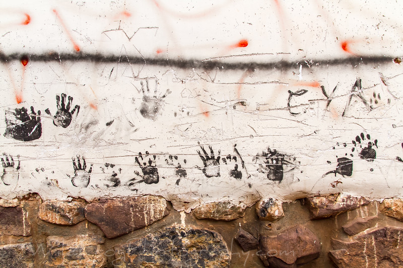 Kids hand prints on the old wall