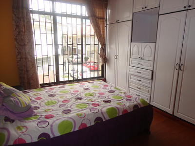 This was the guest room in our first apartment in Cuenca. It consisted of a bed and cabinets. Linens were provided by the landlord. Do yourself a favor and bring your own sheets.