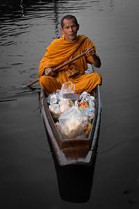 Monk Collecting Alms at Amphawa River