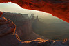 Mesa Arch, with Washer Woman and Monster Tower in background at sunup, Canyonlands National Park, Utah, #0503