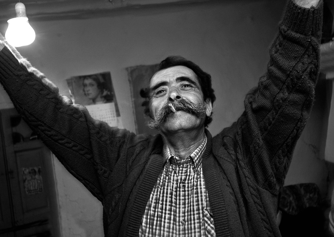 Gypsy man dancing during a Christmas party.