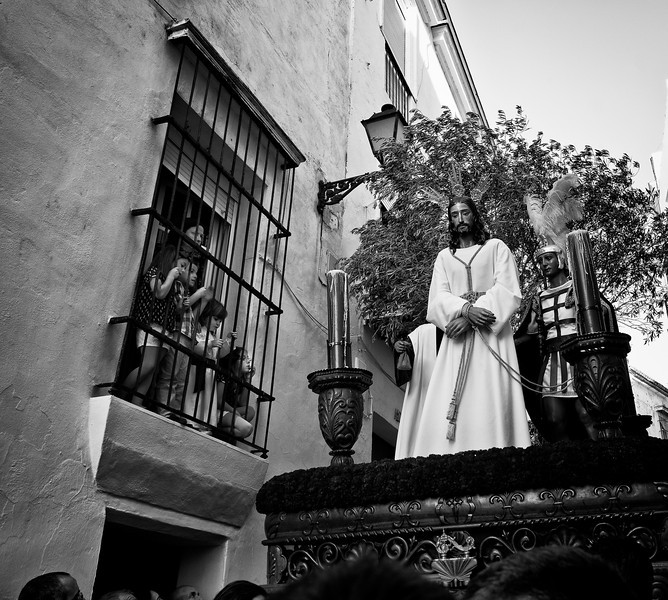 An image of Christ is taken around the narrow streets of the village during an Easter processions.<br /> <br /> Arcos de la Frontera, Andalucia, Spain, 2014
