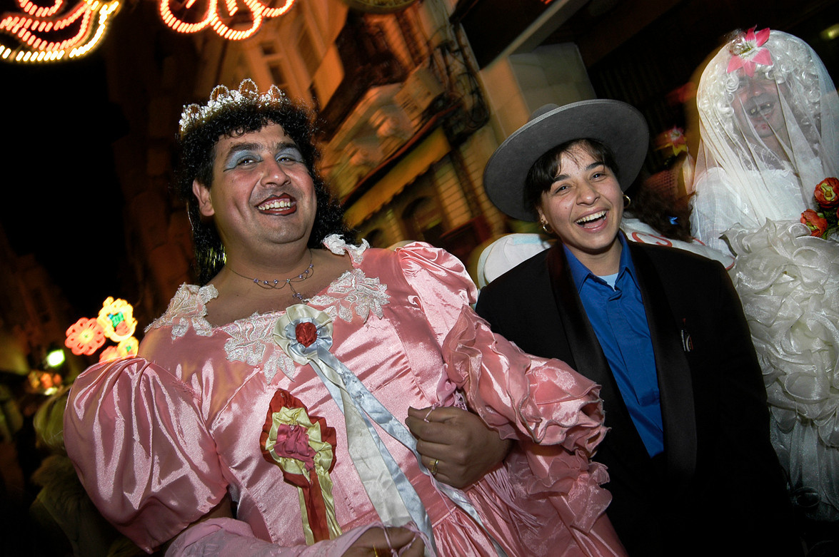 Carnival is a festive season which occurs immediately before Lent; the main events are usually during February. Carnival typically involves a public celebration or parade combining some elements of a circus, mask and public street party. People often dress up or masquerade during the celebrations, which mark an overturning of daily life <br /> In Cádiz the costumes worn are often related to recent news, such as the bird flu epidemic in 2006, during which many people were disguised as chickens. The feeling of this carnival is the sharp criticism, the funny play on words and the imagination in the costumes, more than the glamorous dressings. It is traditional to paint the face with lipstick as a humble substitute of a mask.<br />  <br /> La Linea de la Concepcion, Cadiz,  Andalucia, Spain