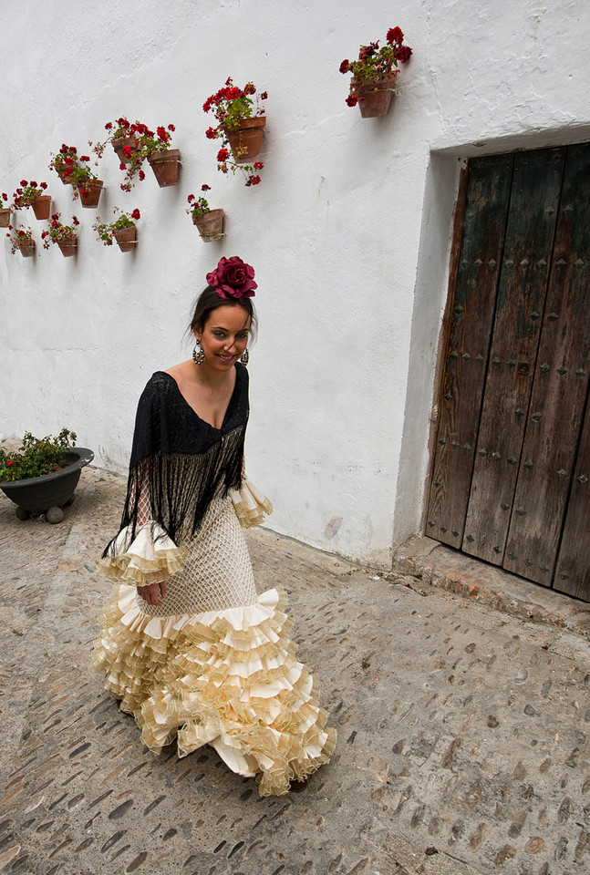 The traje de flamenco has undergone changes over the century or more that it has been in widespread use. For example, in the 1960s and '70s, the skirts got shorter, with skirts reaching only to the middle of the calf or even to the knee. Beginning in the 1970s, the hemlines dropped back to the ankle.<br /> <br /> Arcos de la Frontera, Andalucia, Spain, 2014