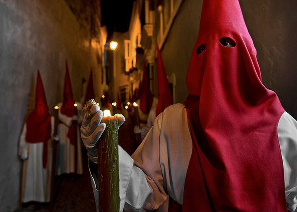 "Spain is known especially and for its Holy Week traditions or Semana Santa. The celebration of Holy Week regarding popular piety relays almost exclusively in the processions of the brotherhoods or fraternities. These associations have their origins in the Middle Age, but a number of them were created during the Baroque Period, inspired by the Counter reformation and also during the 20th and 21st centuries. The membership is usually open to any Catholic person and family tradition is an important element to become a member or ""brother"" (hermano).  Arcos de la frontera, Andalucia, Spain, 2014"