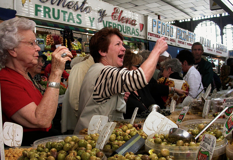 Women at a local market in Malaga.<br /> <br /> Andalucia, Spain.