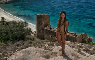 A young lady on a deserted cove.