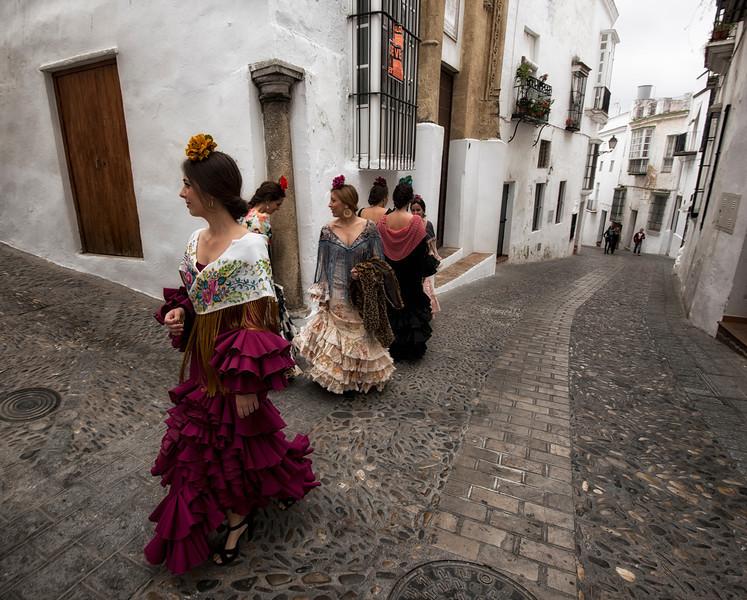 Women in flamenco dress.<br /> <br /> Arcos de la Frontera, Andalucia, Spain, 2014