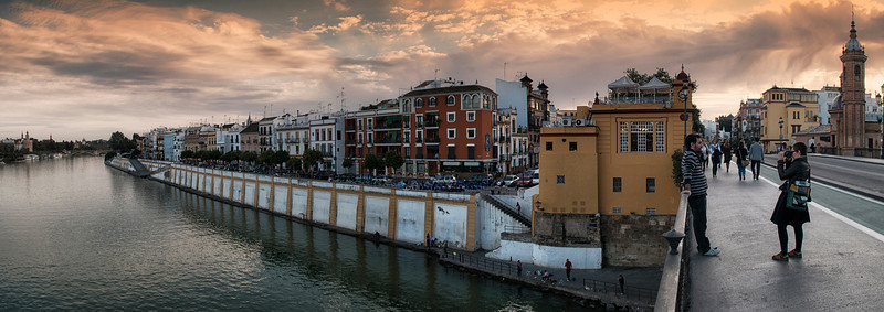 View of Triana and the Guadalquivir river with the Torre del Oro in the distance, from the Puente de Triana in Sevilla,<br /> <br /> Andalucia, Spain, 2011.