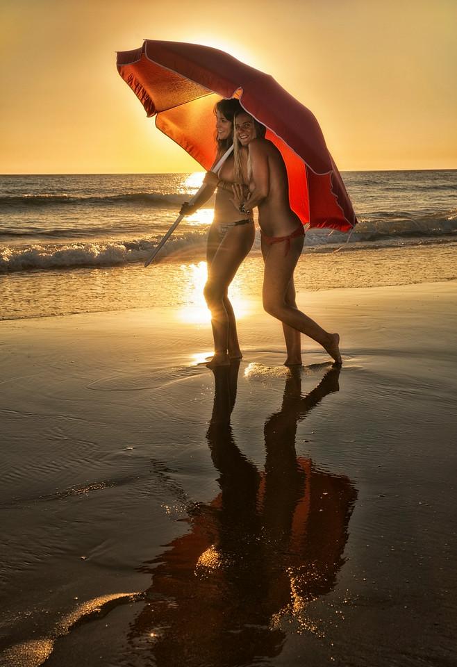 Two women enjoying a stroll along the El Palmar beach.<br /> <br /> Vejer, Andalucia, Spain