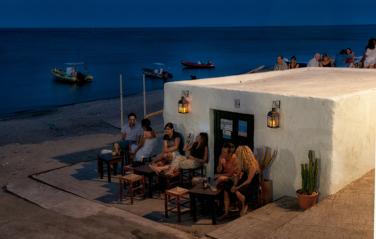 people enjoying a warm summers night.<br /> <br /> Las Negras, Cabo De Gata, Almeria, Spain.