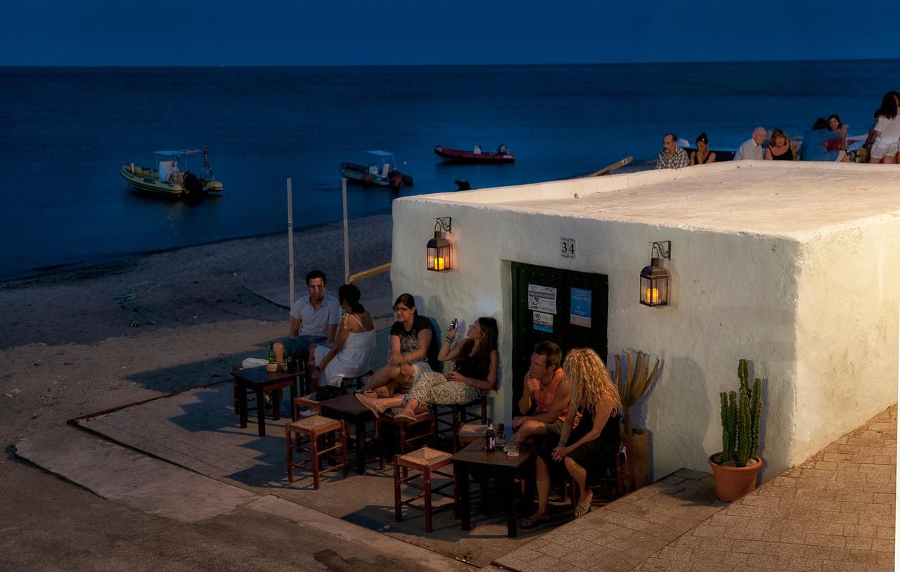 people enjoying a warm summers night.<br /> <br /> Las Negras, Cabo De Gata, Almeria, Spain.