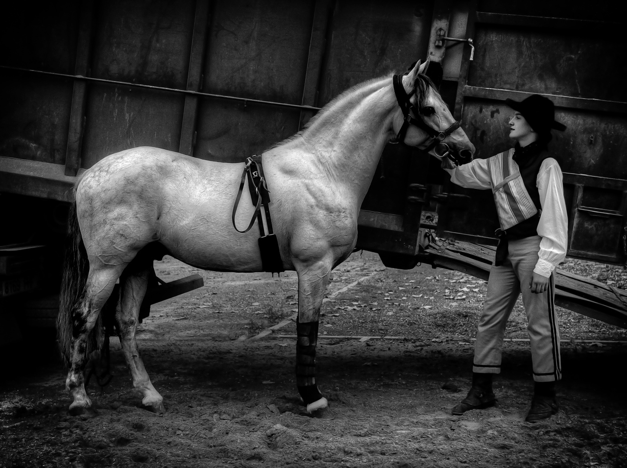 Boy dressed as a Bandolero with his horse.<br /> <br /> Guadiaro, Andalucia, Spain, 2011.