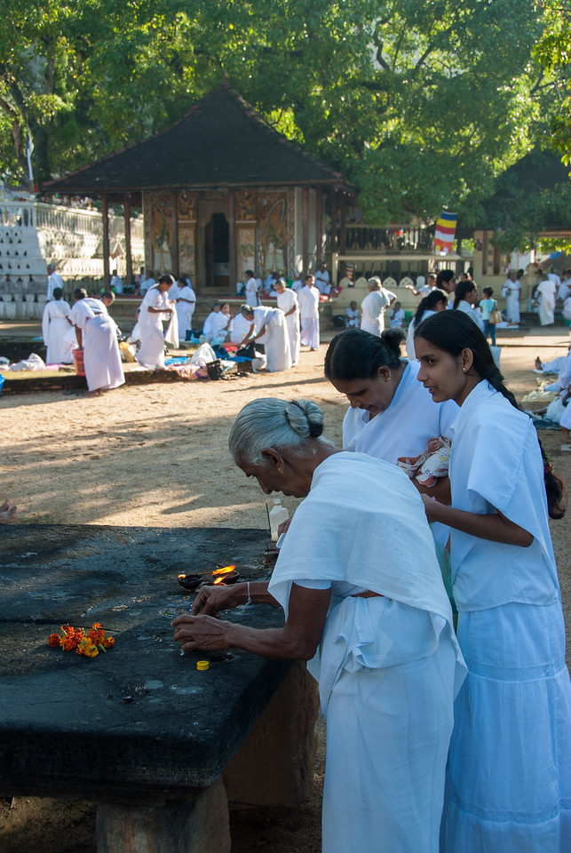 At Natha Devale shrine with its presiding divinity the Mahayana Bodhisattva Avalokitesvara. The shrine of the female Divinity the Pattini is well known for curing infectious diseases. All four devales are provided with small scale Buddhist monasteries, indicating the syncretistic nature of the respective shrines. Kandy, Sri Lanka.