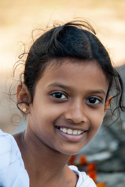 Little girl at the Natha Devale shrine. Kandy, Sri Lanka.