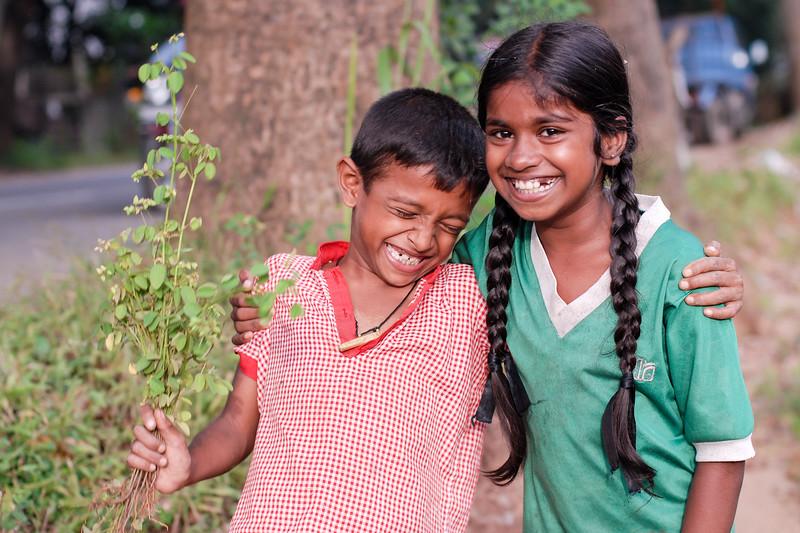 Brother sister having a big laugh in Sri Lanka.