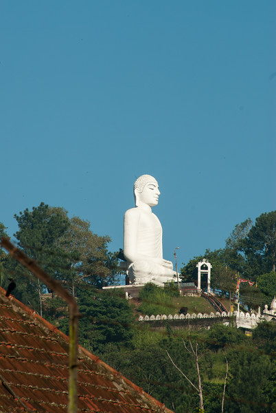 Buddha statue near Kandy Clock Tower, Sri Lanka.