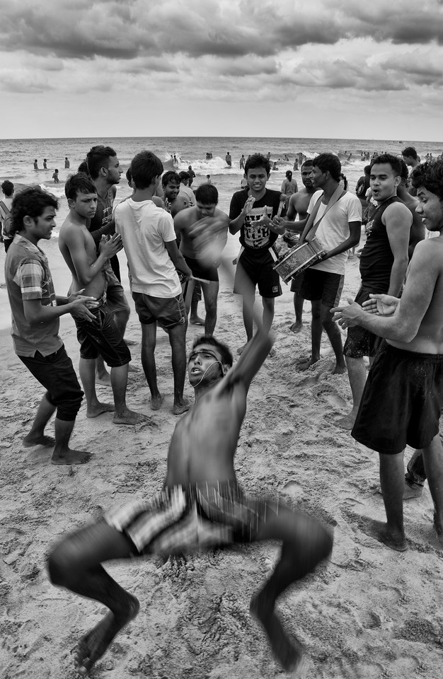 Youths at Negombo beach playin music and dancing on Christmas day.<br /> <br /> Negombo, sri Lanka, 2014