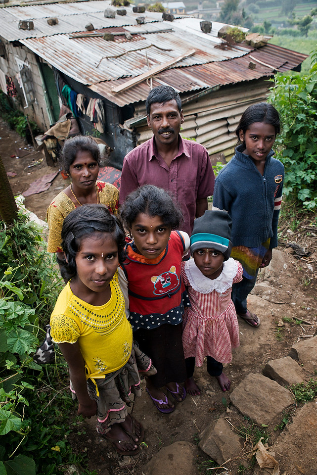 Sri Lanka has had its own distinct community of Tamil people for thousands of years. As with all the people of the island, the Ceylon Tamil community originates in India. The earliest Tamil settlers came from the very far south of India in prehistoric times. Early historic records show that further Tamil groups moved to Sri Lanka from a very large part of India, from the areas now covered by the current Indian states of Orissa, Andhra Pradesh, Tamil Nadu, Kerala and Karnataka. In ancient times, these states were part of the Dravidian Chola, Pandya and Chera kingdoms, and as these kingdoms expanded southwards, Tamils made the crossing into Lanka and established a foothold on the island. The first of these incursions pre-dates written records and a great deal of information about the earliest Tamil settlement of Sri Lanka is quasi-mythical or legendary. Subsequent movements of South Indian people are better documented, including the Chola and Pandyan invasions of the island, and the migration of families from the chettiar caste from South India in the 1700s. The most recent migration of Tamils to Sri Lanka took place in the 1800s under the British administration of the island. These most recent migrants have had a sad history of exclusion from previous Tamil arrivals on the basis of caste discrimination. As a consequence of these periodic migrations, some documented, some not, heated debate still continues about the origins of the Tamils and their place in modern Sri Lanka.<br /> <br /> AR aged 40 and his wife Vigilaksmi aged 35, have four  children. They all live together in one of the many small villages catering for the tea plantation labourers. This Tamil family of tea pluckers has been working in the industry for over ten years. Although they earn a meager wage, this at least guarantees food and education for their four children. <br /> <br /> Nuwara Eliya, Sri Lanka.