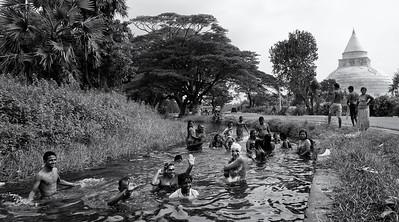 Pilgrims stop to wash before entering the holy city of Kataragama.  Sri Lanka, 2014.