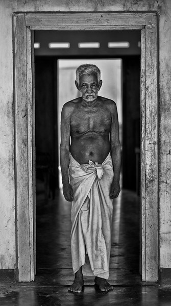 Semi is a 79 year old cook who has spent most of his life feeding the Buddhist monks at the 700 year old Gane Gode temple. Semi lives in the temple grounds together with four resident monks.  Sri Lanka, 2014
