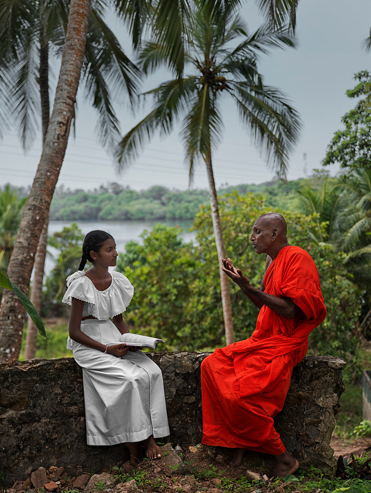 In Sri lanka students attend school on Saturday mornings where they receive an education on ethics and Buddhism. Sometimes Buddhist monks attend the schools and help the teachers impart the teachings of Buddha.<br /> <br /> A Buddhist monk and his Student.<br /> <br /> Sri Lanka, 2014.